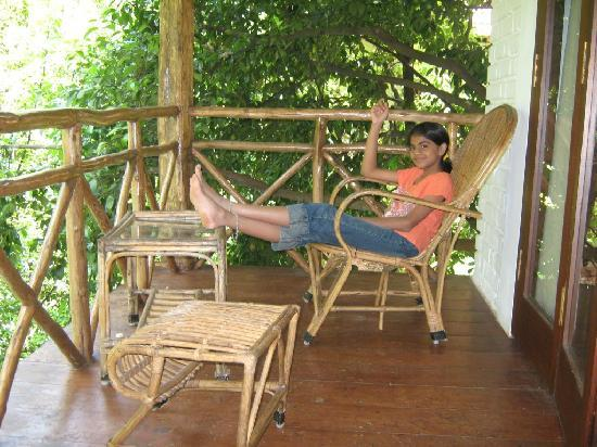 Kurumba Village Resort: Ammu puts up her feet in the balcony of our cottage
