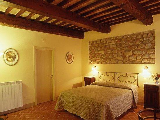 La Mia Toscana: una delle camere arredate in stile toscano