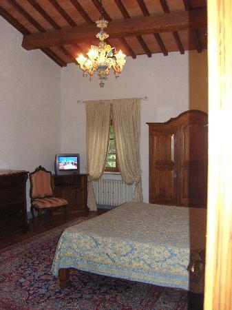 Villa Poggio ai Merli: camera da letto