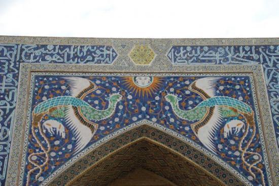 Nodir Devon Begi Madrasasi: 16 December 2009.  Bukhara, Uzbekistan.  Phoenix holding onto pigs, meaning Halal.