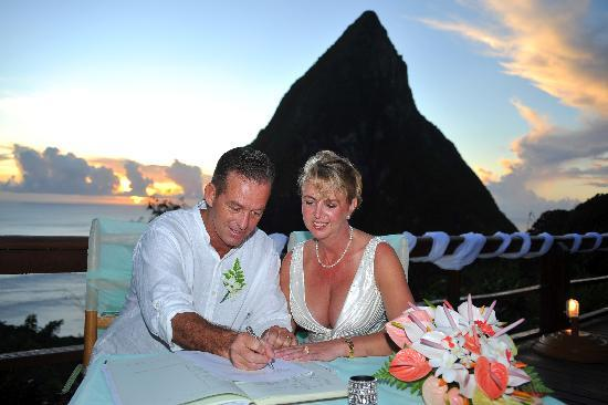 Signing the register with Pitit Piton in the background