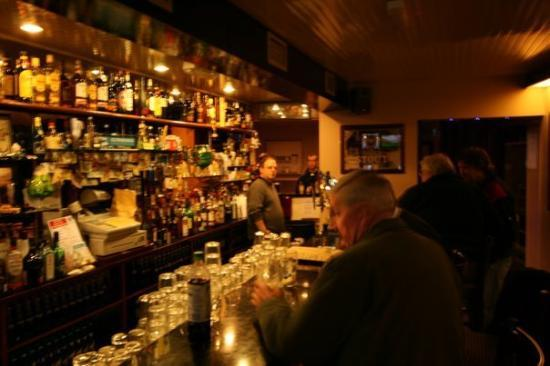 Inside the T. J. Loftus Pub, Tuam, County Galway.  Tommy Loftus behind the bar.