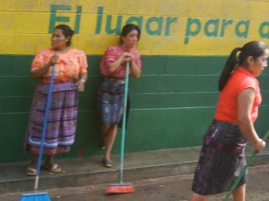 Santa Cruz del Quiche, Guatemala: It seemed that every one in the town was outside with their brooms sweeping the water around the