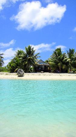 Inano Beach Bungalows: View of Inano whilst floating in the lagoon