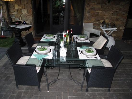 Bagno a Ripoli, Italy: Patio table set for dinner at the villa.