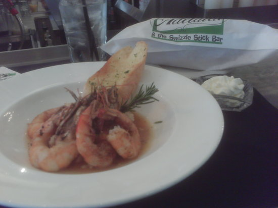 Cafe Adelaide & The Swizzle Stick Bar: Shrimp & Grits (with fresh bread in white bag)