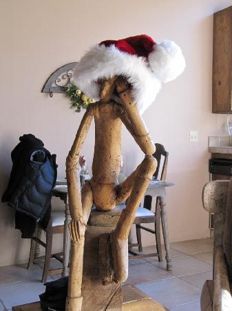 Adobe Village Inn: the resident funky stick-man turned santa