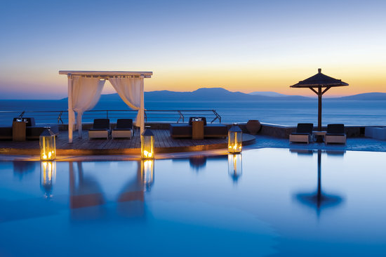 Mykonos Grand Hotel & Resort: Sunset by the Pool