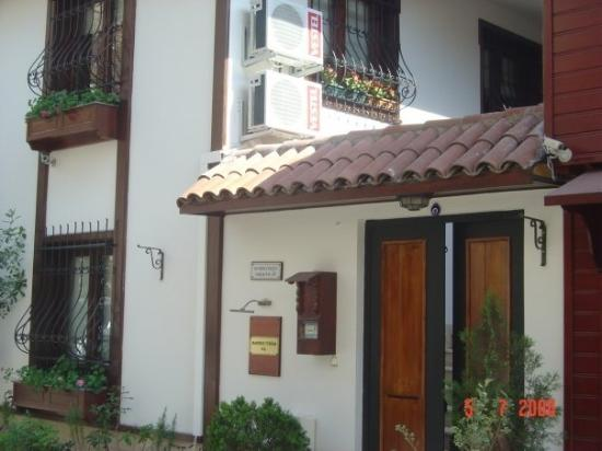 Villa Sphendone Suites: The 3 windows above the entrance was our room.  The double wooden door was the only entrance to