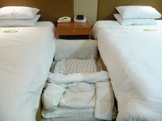 "Savoy Hotel Seoul : We made a ""nest"" for our baby to sleep in since there were no cribs"