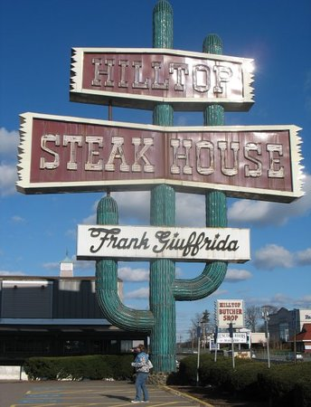 Hilltop Steak House : thats me down there, crazy big sign at hilltop