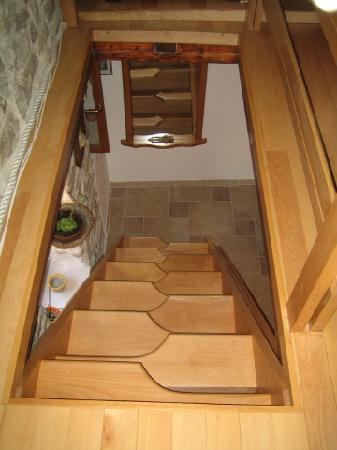 Salvezani Apartment: stairs in attic space, app.no1