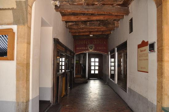 Hotel Adler: hallway next to tavern to enter hotel