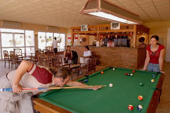 Pool, darts, television, books and games in Friends' Pub at Swisscare Nuweiba Resort Hotel