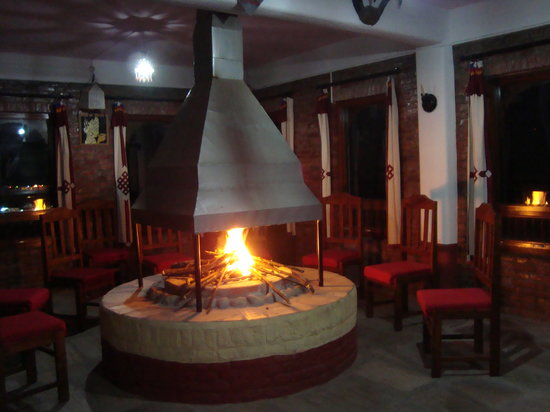 Resort Eco Home: fire place in the restaurant