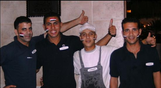Jaz Mirabel Park: Amr Saied 2nd from left - excellent staff at pool bar before Egypt - Algeria match