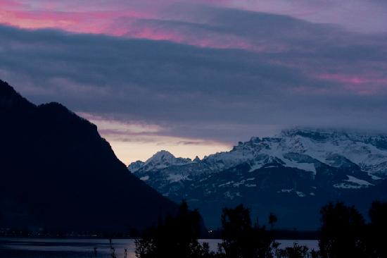 Eden Palace au Lac: sunrise view of lake and Alps from balcony