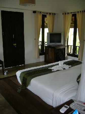 Room bed and front door.