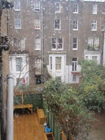 Barmy Badger Backpackers: view from bedroom window - hostel courtyard...would be great in summer!