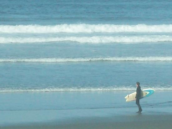 Long Beach Lodge Resort: surfer and the surf - from hotel restaurant