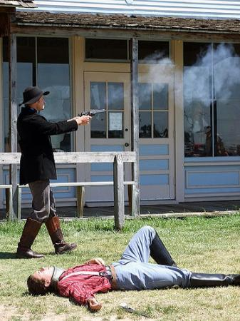 Dodge City, KS: Cowboys fighting at Boot Hill