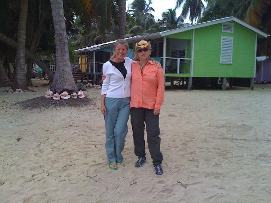 Tobacco Caye Lodge: Barbara and my wife, cabins behind