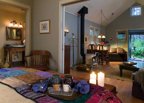 WildSpring Guest Habitat: Annwyn cabin, filled with art and antiques, with an extended livingroom and woodburning stove