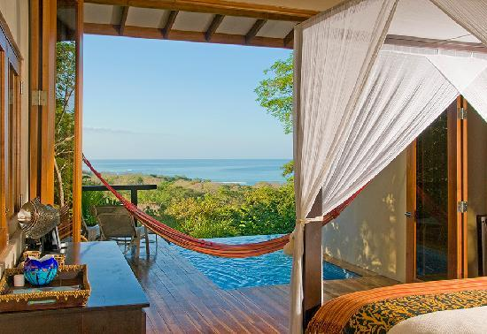 Casa Chameleon Hotel Mal Pais: Wake up surrounded by lush tropical gardens and amazing ocean views in your private villa.