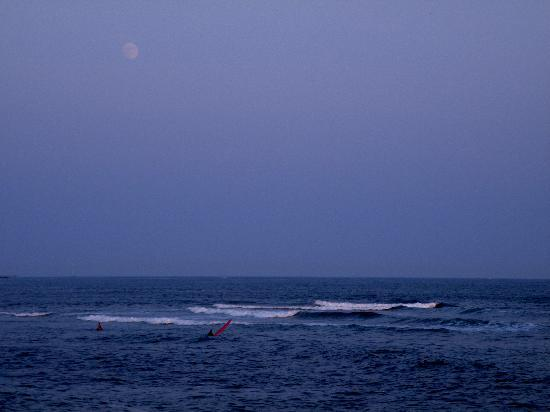 Ocean Mist: View of surfers & the moon, from our table