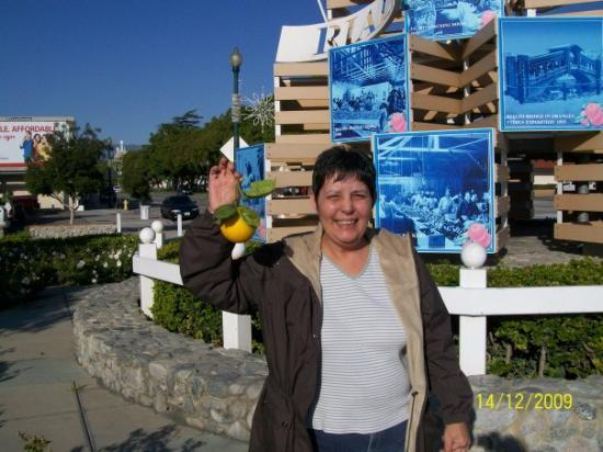 My sister Gail holding the orange that she picked. We took the train to Rialto.
