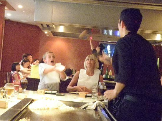 Stamford Plaza Auckland: A boy at our table attempting to catch an egg . . . (yes, he was successful!)