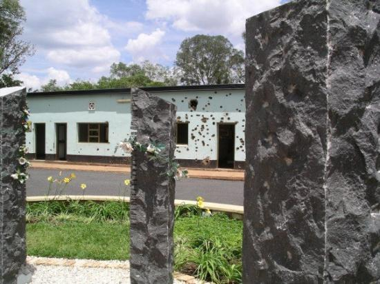 Kigali, Rwanda: Memorial to the 10 Belgian UN soldiers who died in the blue building in the background.
