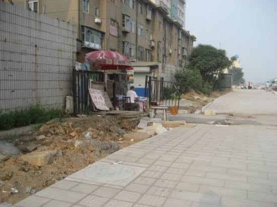 Busy Street Sidewalk Merry go round ...