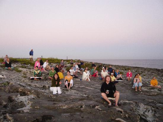 Sivananda Ashram Yoga Retreat : Morning meditation and chanting on the beach