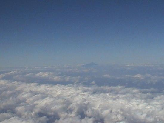 Grande Comore, Comoros: First sighting of Grand Camore through the clouds with the prominent volcano Karthala evident