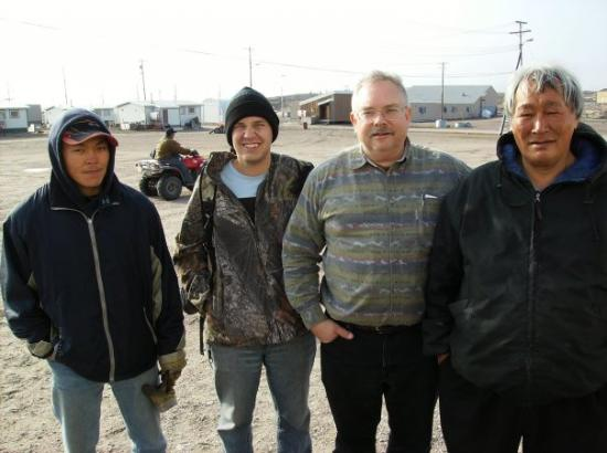 Repulse Bay, Canada: Arctic Circle hunting party, Phillip (guide) Erik (hunter), John (hunter) & Santa Kidlopik (mast
