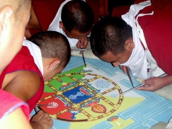 Dharamsala, India: Monks making a sand mandala in the Karmapa's Temple