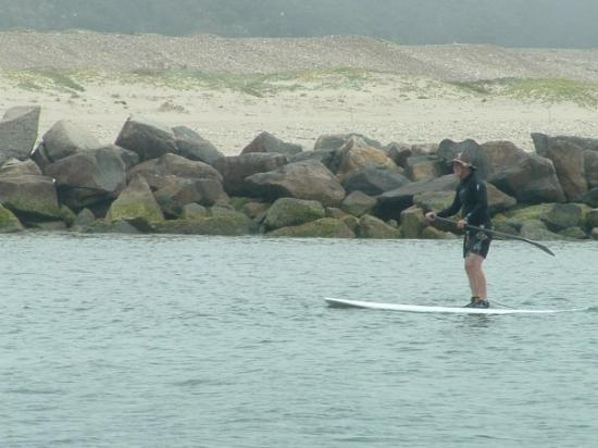 Central Coast Outdoors: a guy on a surf board moving along with a paddle...very cool