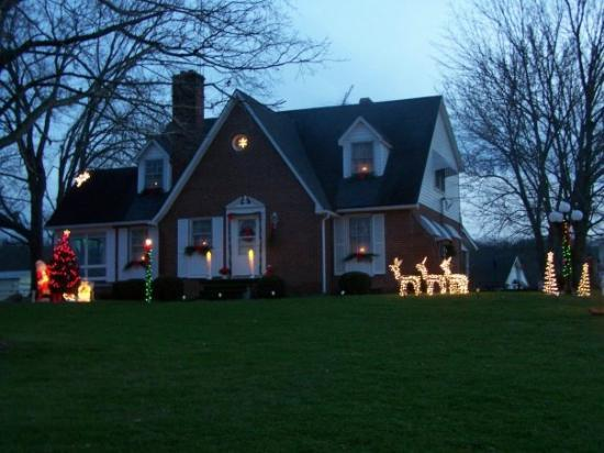 Crab Orchard, KY: the house lit up just before dark