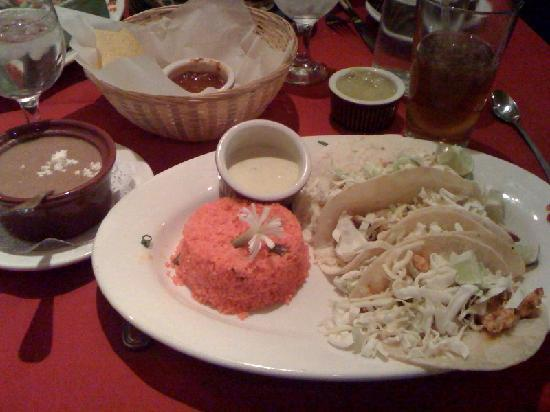 Reyes Adobe: fish tacos...authentic Mexican rice and sauce for tacos along with re-fried beans