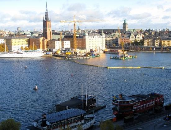The Red Boat Hotel & Hostel: The Red Boat in the foreground with Gamla Stan in the background, viewed from Monteliusvagen