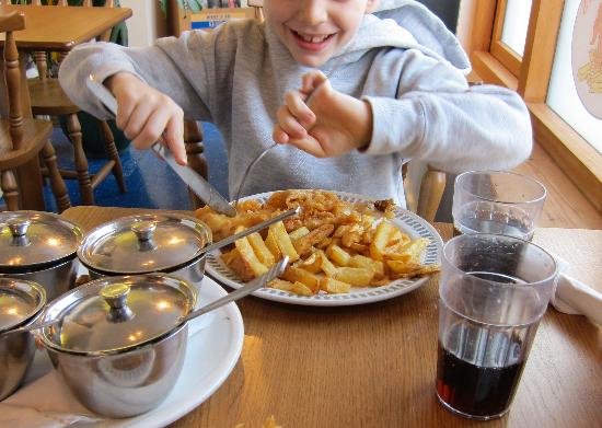 Fish-over-Chips: Not normally a food enthusiast, the junior tucks in