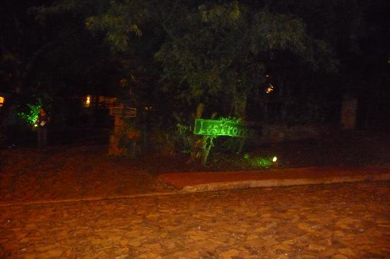 Jasy Hotel: The pool by night