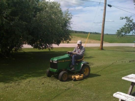 Fisher Branch, Canada: dad on his lawnmower