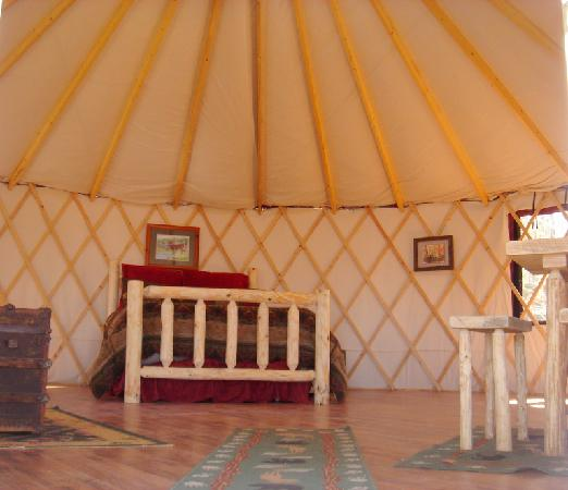 Blanche Manor Yurts: This is the inside of the yurt and shows the queen bed with full trundle underneath.