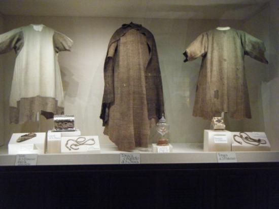 Basilica di Santa Chiara: St. Francis's clothes (outside) St. Clare's clothes (center)