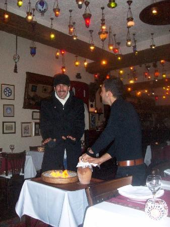 Antique Turquoise Restaurant : Vice - playfully warming his hands over the Testi's cooking fire