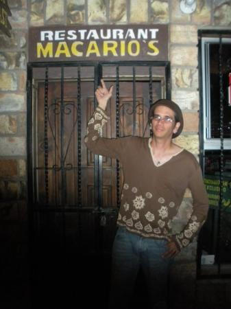 Rosarito, México: Here I am standing in front of a closed restaurant. Why am I pointing up at the sign? Well, it h