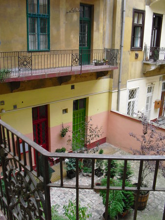 Happy Holiday Hostel : The view from apartment front door into courtyard below...