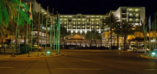 The front of the Mövenpick hotel at night